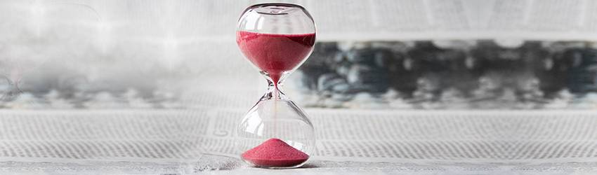 An hourglass with red sand.