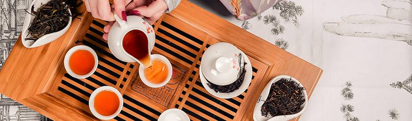 Someone is pouring tea in a traditional chinese tea ceremony.