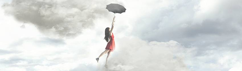 A person dreaming that they are floating away into the air while holding an umbrella.
