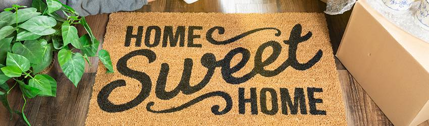 A welcome mat that says