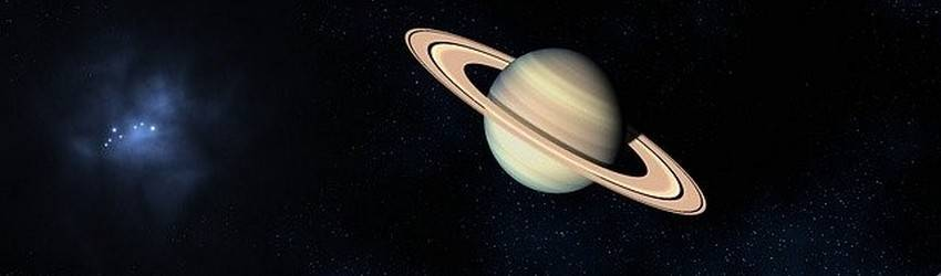 The planet Saturn in dark space.