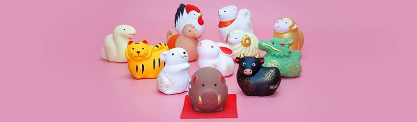 All the Chinese Zodiac animals but they are little figurines. They are cute and on a pink background.