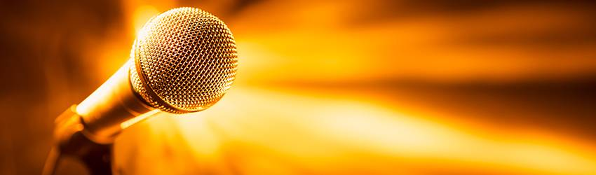 A microphone facing the frame, surrounded by orange light.