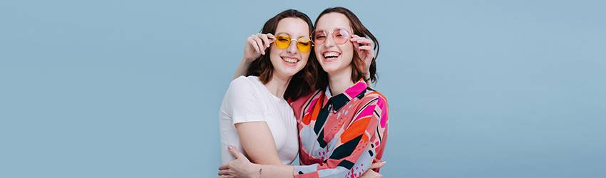 Twins pose together representing the Virgo Libra cusp.