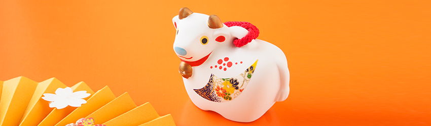 An Ox figurine on an orange background signifying that it is the year of the Ox.