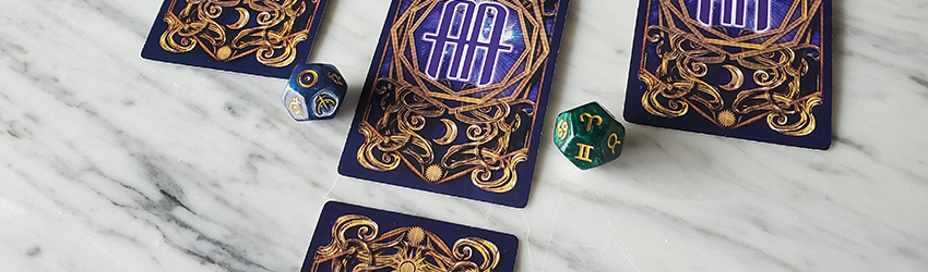 A four card tarot spread for Aries season shown on the Astrology Answers Master Tarot Deck. It is in the shape of the Aries ram and is on a white marble table.