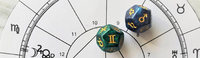 Astrology dice showing the symbols for Gemini man on an astrology chart.