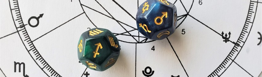 Astrology dice showing the symbols for sagittarius man on an astrology chart.