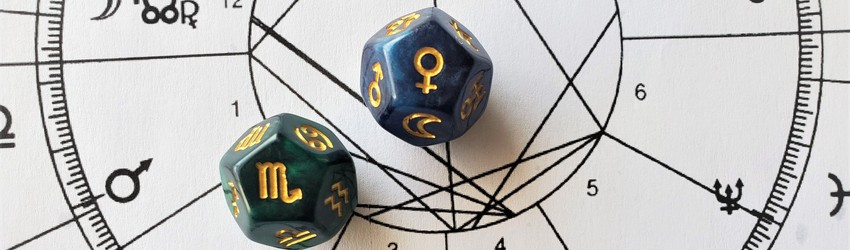 Astrology dice showing the symbols for Scorpio woman on an astrology chart.