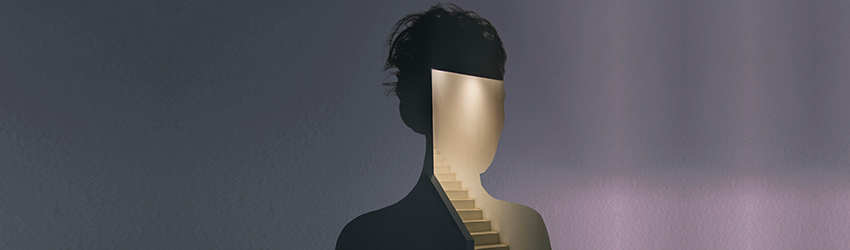 A woman is silhouetted with a staircase in behind her.
