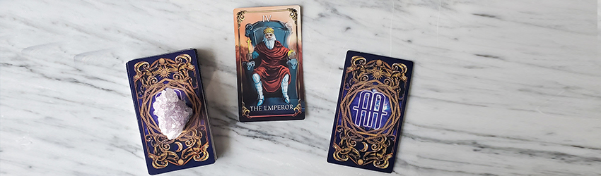 January Tarotscopes shown on the Astrology Answers Master Tarot Deck with party beads at the top of the frame.