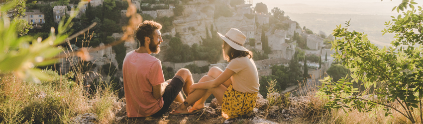 Two people chatting on a hill in Greece.