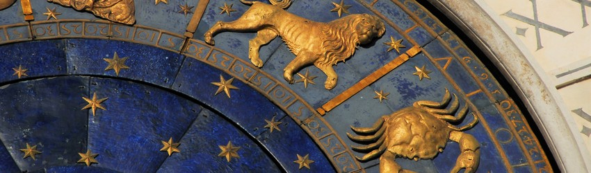 An astrological clock that shows that it is just between Cancer and Leo season.
