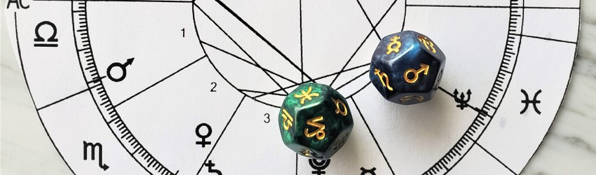 Astrology dice showing the symbols for Capricorn man on an astrology chart.