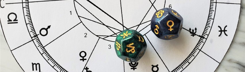 Astrology dice showing the symbols for Capricorn woman on an astrology chart.