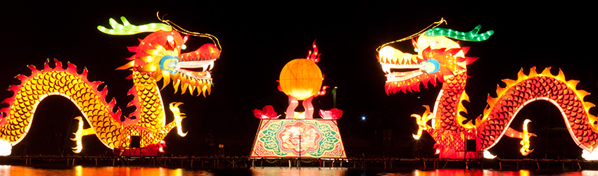 Two chinese dragon lanterns face each other.