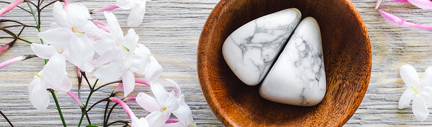 A White Howlite crystal is in a bowl.