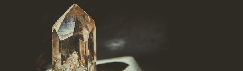 Some quartz crystal sits on a table.