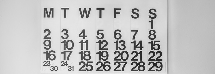 A calendar on the wall of an entire month.