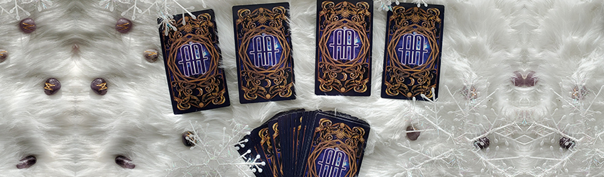 December Winter Solstice 4-card Tarot spread laid out with the Astrology Answers Master Deck on white fur.