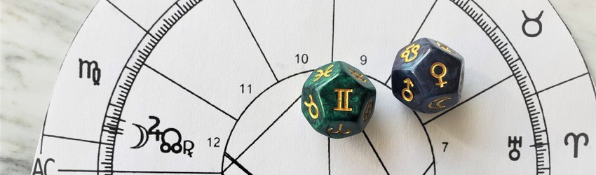 Astrology dice showing the symbols for Gemini woman on an astrology chart.