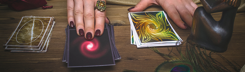 A Tarot reader conducts a tarot reading on one of three decks.