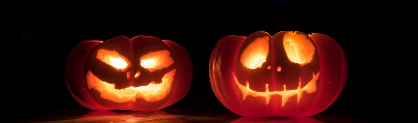 Two Jack O' Lanterns sitting on a step on Halloween in a dream.