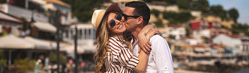 A stylish and fun Leo couple hold each other while posing for a picture.