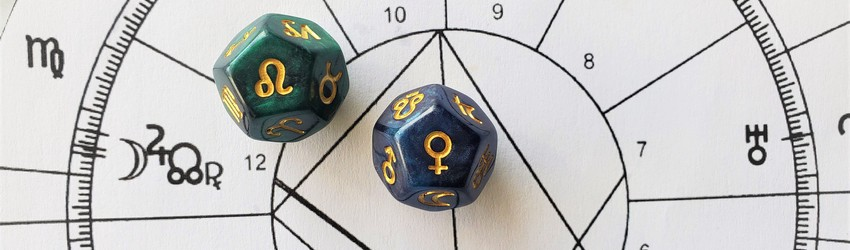 Astrology dice showing the symbols for Leo woman on an astrology chart.