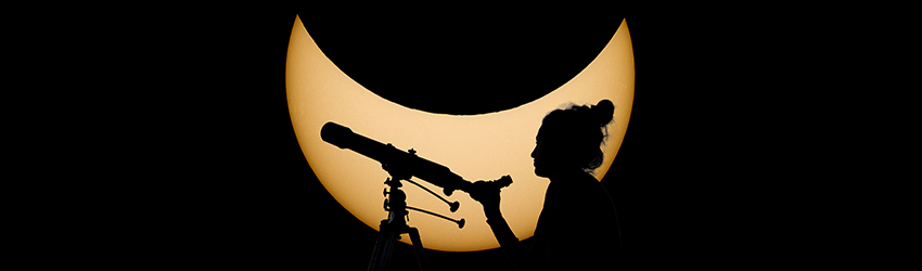 A woman looks through a telescope at a Moon in Cancer.