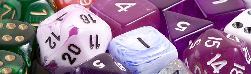 A bunch of beautiful purple and green dice.