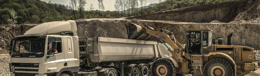 A quarry filled with construction vehicles.