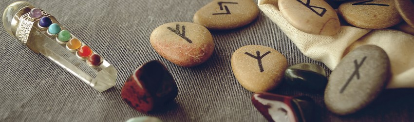 rune stones with crystals on table
