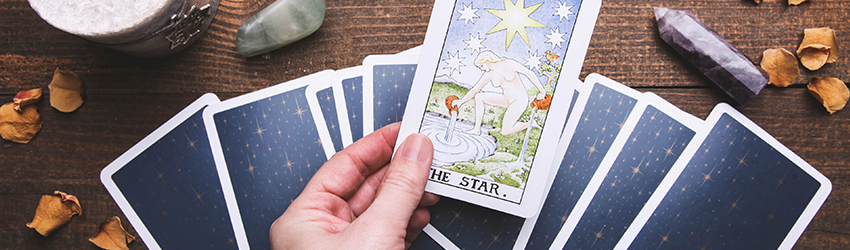 Tarot cards with stars on the back of them.