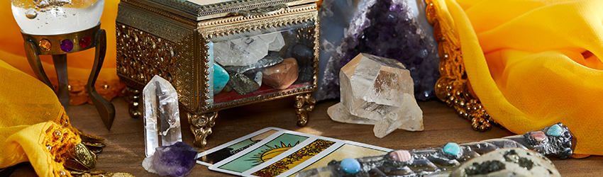An altar with crystals and tarot cards on it.