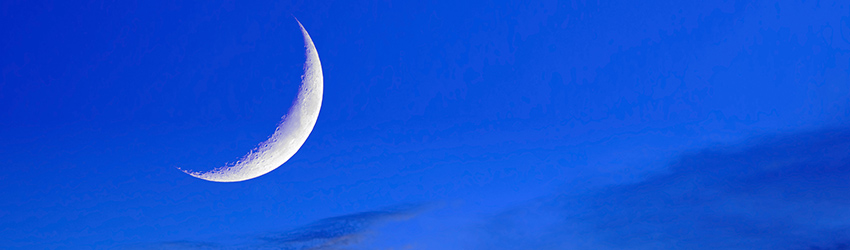 A new moon in a blue sky.