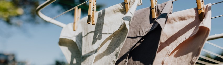 Some underwear hangs on a clothesline to dry.