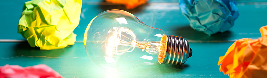 A lightbulb with crumpled paper around it.