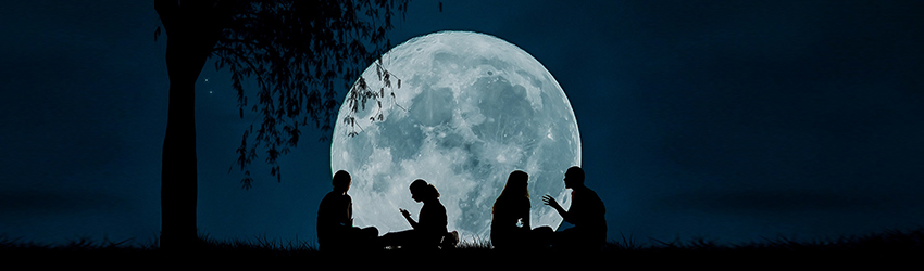 Four people having a picnic in front of a white full moon.