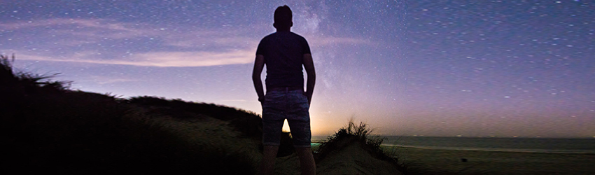 Man standing in front of the stars.