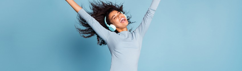 woman-with-headphones-dancing-to-music