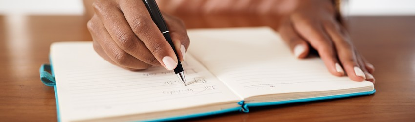 hand-writing-in-a-journal