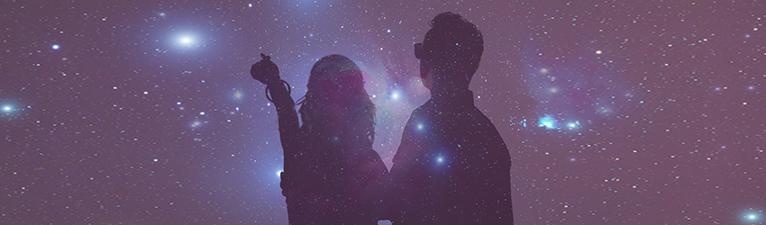 A shadow of two people pointing at the moon. The background is a purple sky with stars.