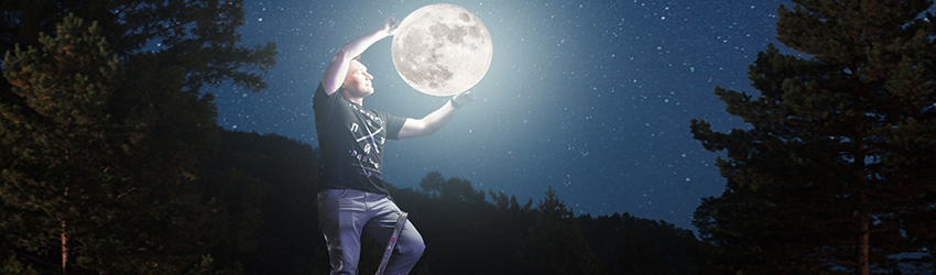 A man on a ladder holds the Moon between his hands.